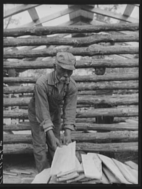 Evicted sharecropper building a cabin. Butler County, Missouri