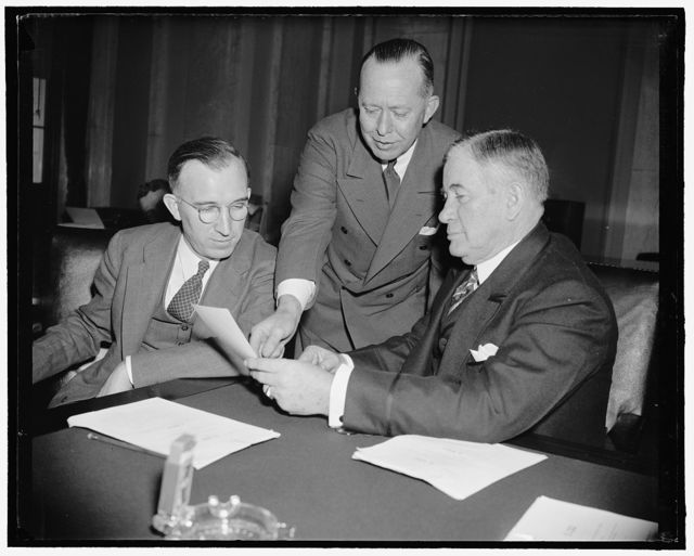 FAC Head appears before Senate committee. Washington, D.C., March 31 -F.F. Hill, left, Governor of the Senate Banking and Currency Subcommittee which is considering pending bills relating to mortgages held by agencies of the F.C.A. Hill is shown with Chairman Alben W. Barkley of the Committee, and Payton R. Evans, General Counsel of the F.C.A. 3-31-39