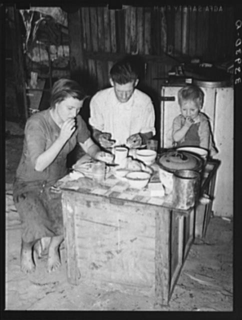 Family eating breakfast. Mays Avenue camp, Oklahoma City, Oklahoma. See general caption no. 21