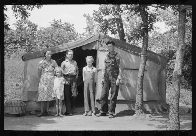 Family of agricultural day laborers living in tent near Spiro, Oklahoma. This family had farmed in this vicinity for twenty-five years but could no longer find a place to rent. They had no money and no car but hoped to get work in the potato fields and chopping cotton and picking roasting ears. They wanted to buy a car and get on to California but if they couldn't make it the man said they couldn't run him out of Oklahoma
