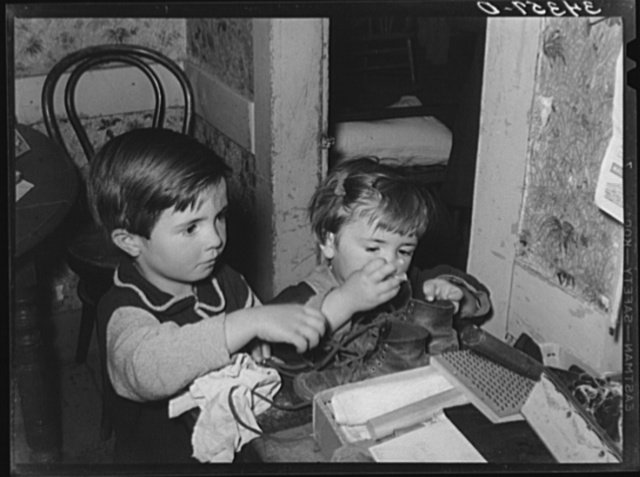 Farm children playing with articles on table. Farm home near Bradford, Vermont. Orange County