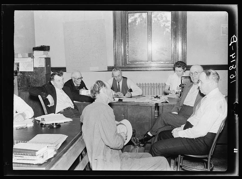 Farm Debt Adjustment Committee meeting with farmer who has appealed for assistance. He has been threatened with foreclosure and loss of farm. Ozark Mountain town of Harrison, Arkansas