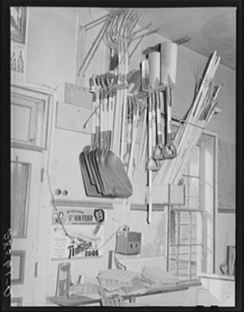 Farm implements and egg candler. General store. Lamoille, Iowa