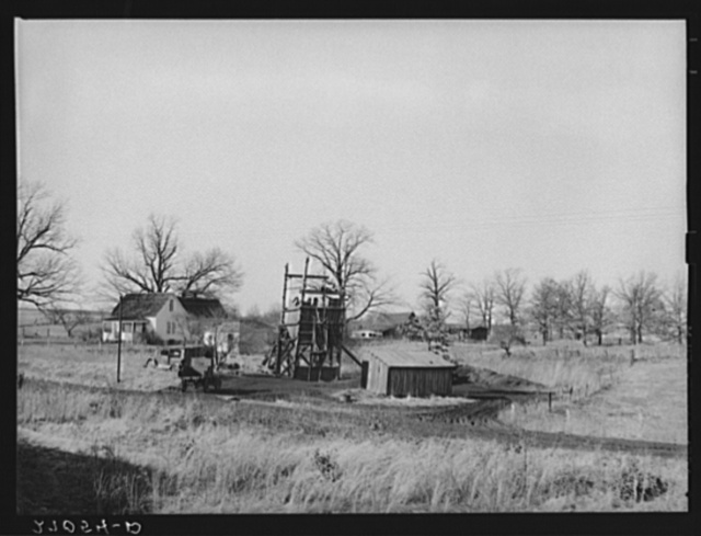 Farm on which a gopher hole has been placed, with agriculture giving way to coal mining. Williamson County, Illinois