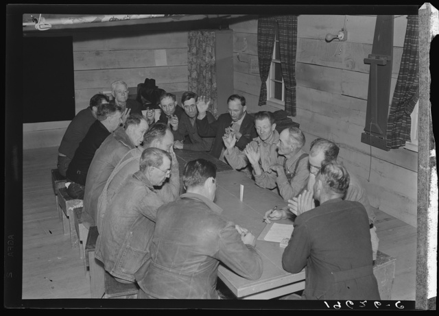 Farm Security Administration (FSA) camp for migratory agricultural workers. Farmersville, California. Meeting of camp council