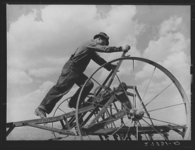 Farmer adjusting cultivator. Fairfield Bench Farms, Montana