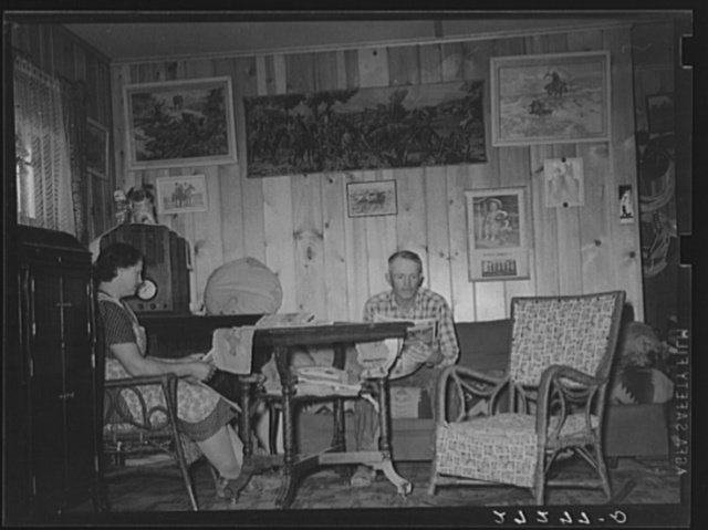 Farmer and wife in living room of new farmhouse. Fairfield Bench Farms, Montana