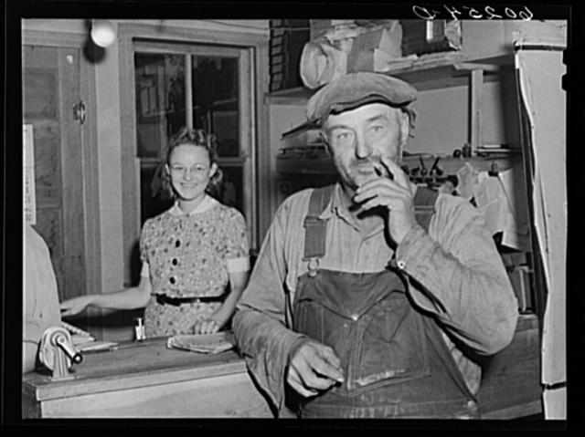 Farmer in office of Border King co-op seed exchange. Williams, Minnesota