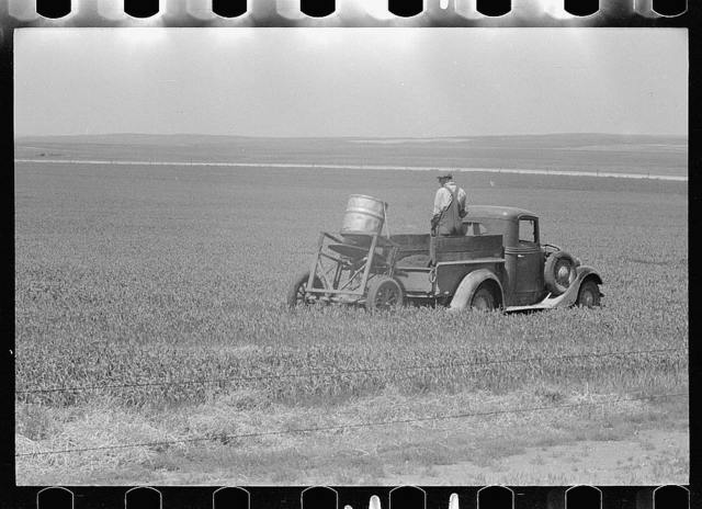Farmers spreading poison grasshopper bait, Richland County, Montana
