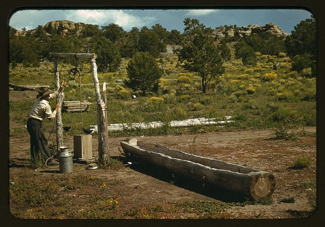 Faro Caudill drawing water from his well, Pie Town, New Mexico