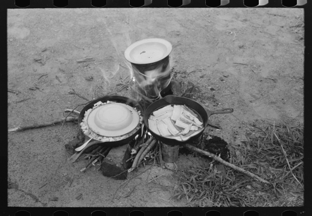 Fatback, potatoes and coffee being prepared by migrant family at Henrietta [i.e., Henryetta,] Oklahoma