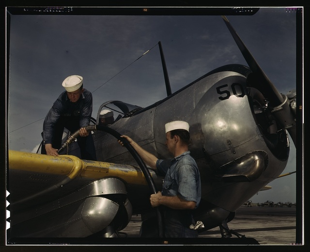 Feeding an SNC advanced training plane its essential supply of gasoline is done by sailor mechanics at the Naval Air Base, Corpus Christi, Texas