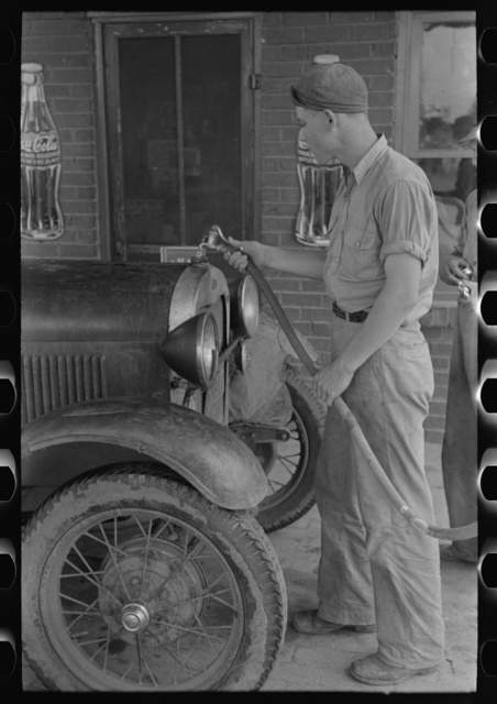 Filling radiator of migrant car with water. This is done frequently, as these radiators usually leak. Near Henrietta [i.e., Henryetta,] Oklahoma