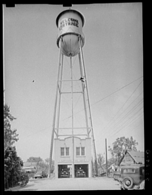 Fire station and water tank. Carthage, Texas