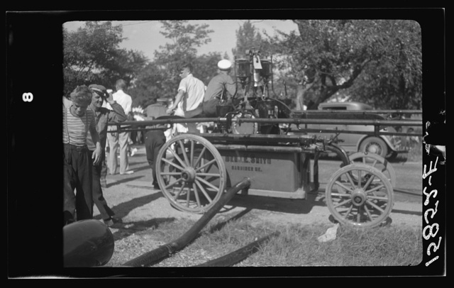 Firemen's muster. Boothbay center, Maine. Typical handpump manned by twenty-four men, twelve along each of the handle bars