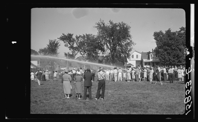 Firemen's muster. Boothbay center, Maine. Volunteer fire companies compete for one hundred dollars to the company which can throw water farthest with hand-operated pumps