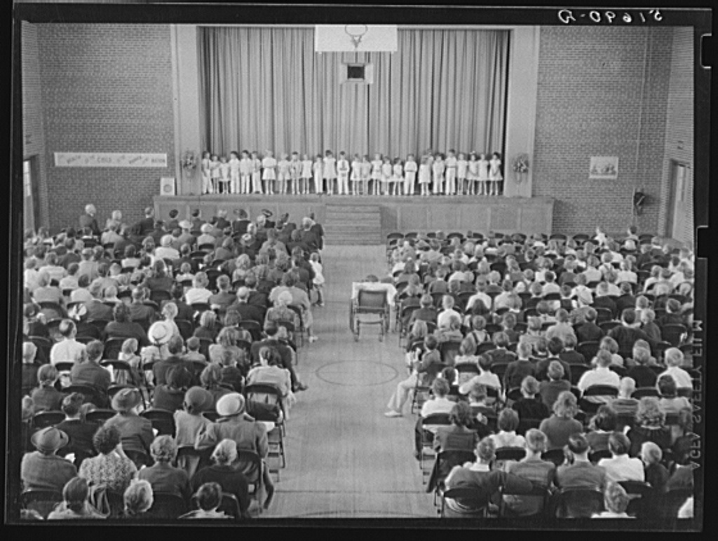 First grade children singing health song in May Day-Health Day program in auditorium. Ashwood Plantations, South Carolina