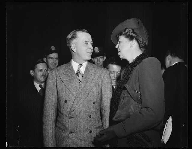 FIRST LADY CHATS WITH ACTING HEAD OF DIES COMMITTEE. WASHINGTON, D.C. NOVEMBER 30. FOLLOWING HER UNANNOUNCED APPEARANCE AT THE DIES COMMITTEE HEARING TODAY, MRS. ROOSEVELT STAYED TO CHAT WITH ACTING CHAIRMAN REP. JOE STARNES, WHEN THE MORNING SESSION ADJOURNED. THE FIRST LADY LISTENED TO TESTIMONY CONCERNING THE AMERICAN YOUTH CONGRESS