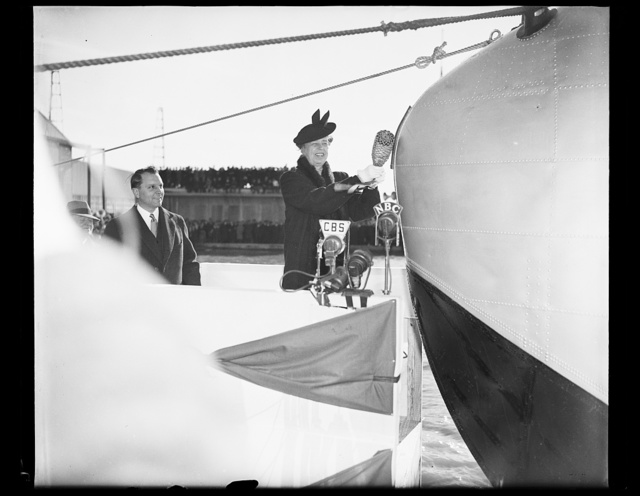 FIRST LADY CHRISTENS YANKEE CLIPPER. WASHINGTON, D.C. MARCH 3. MRS. ROOSEVELT TODAY SMASHED A BOTTLE OF WATER FROM THE SEVEN SEAS ON THE BOW OF THE YANKEE CLIPPER, CHRISTENING THE 40-TON, 74 PASSENGER FLYING BOAT WHICH WILL INAUGURATE TRANSATLANTIC AIR PASSENGER SERVICE. THE CEREMONY TOOK PLACE AT THE U.S. NAVAL AIR STATION HERE