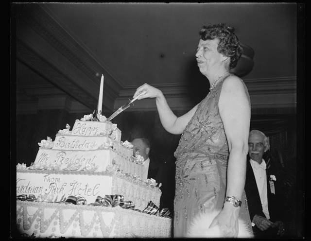 FIRST LADY CUTS PRESIDENT'S BIRTHDAY CAKE. WASHINGTON, D.C. JANUARY 30. MRS. FRANKLIN D. ROOSEVELT CUTS THE OFFICIAL PRESIDENT'S BIRTHDAY CAKE AT WARDMAN PARK HOTEL TONIGHT TO COMPLETE A ROUND OF THE PRESIDENT'S BIRTHDAY CELEBRATIONS IN THE CAPITAL. THE FIRST LADY THEN RETURNED TO THE WHITE HOUSE WHERE SHE LISTENED TO THE PRESIDENT IN A RADIO ADDRESS EXPRESS HIS APPRECIATION TO THE COUNTRY FOR ATTENDING THE BALLS, FUNDS FROM WHICH WILL GO TOWARD THE FIGHT AGAINST INFANTILE PARALYSIS