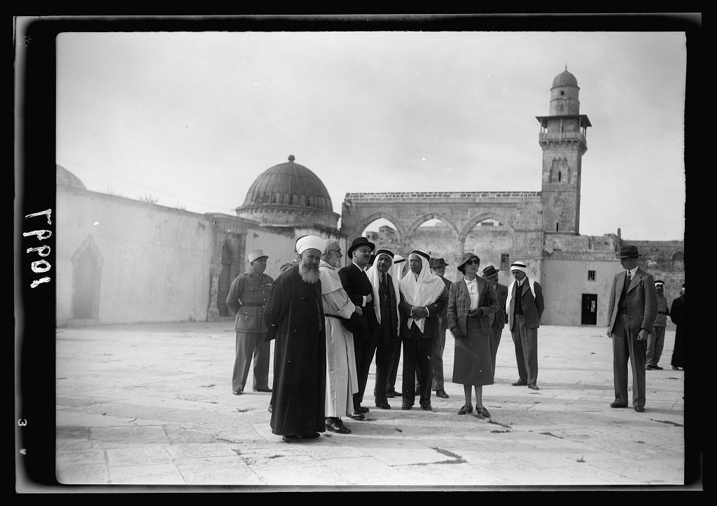 French High Commissioner for Syria visits the Temple Area in Jerusalem, Nov. 18, '39. Commissioner's party admiring the Dome of the Rock, group, minaret in background