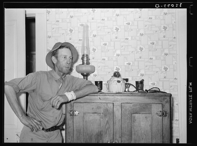 FSA (Farm Security Administration) client leaning on icebox. Hidalgo County, Texas