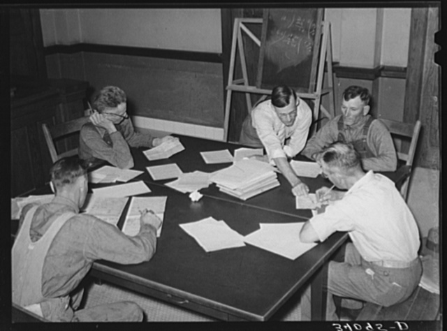 FSA (Farm Security Administration) supervisor explaining plans to clients. Sheridan County, Kansas