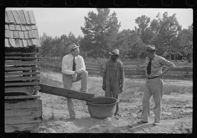 FSA (Farm Security Administration) supervisors with rehabilitation borrower, Greene County, Georgia