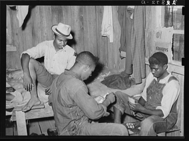"Game of ""coon-can"" played by group of Negroes in bunkhouse of strawberry pickers near Hammond, Louisiana"
