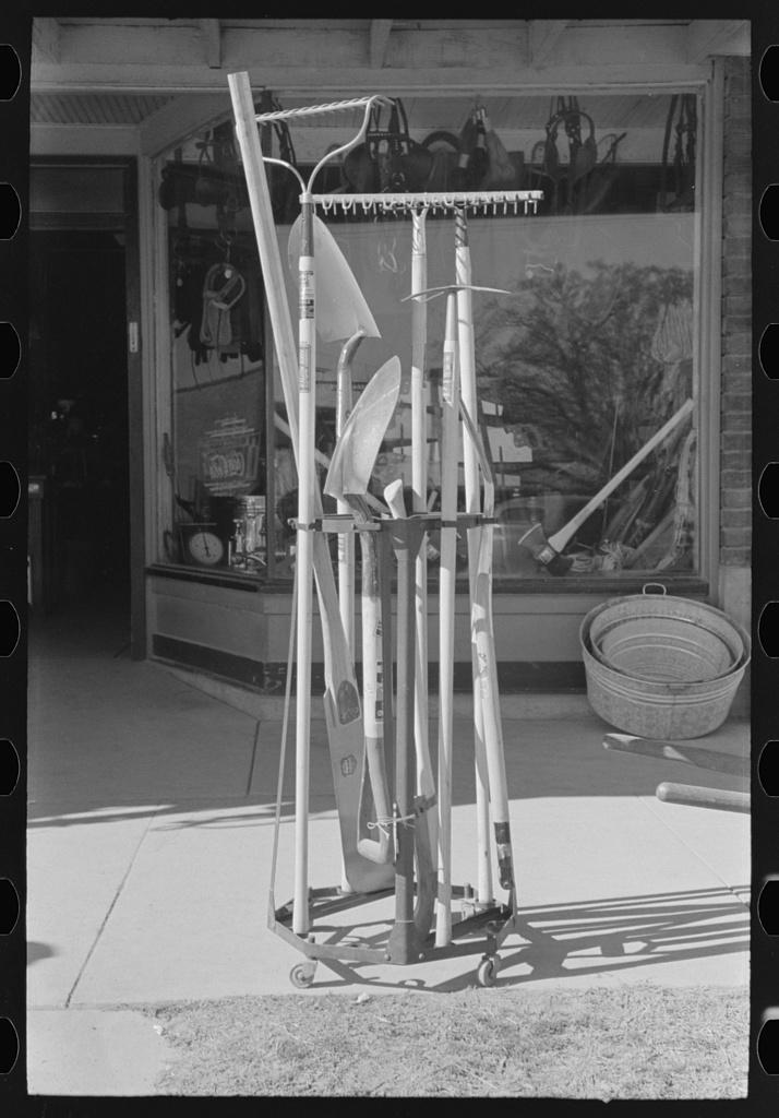 Garden tools in front of hardware store, Eudora, Arkansas