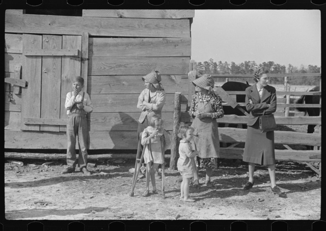 George Cowley's family (rural rehabilitation) with home supervisor, discussing possibilities of further medical care and treatment for child on crutches. Her bones break exceptionally easy (diet deficiency one of causes) and one leg has been broken five times and doesn't mend properly. She is ten years old. Pike County, Alabama