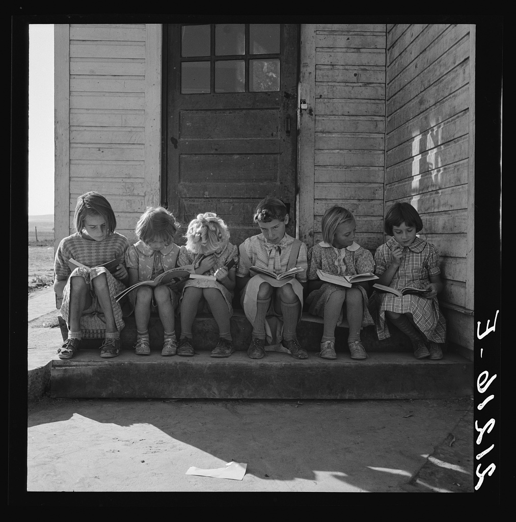 Girls Of Lincoln Bench School Study Their Reading Lesson Near