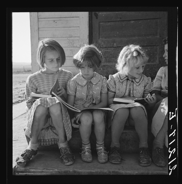 Girls of Lincoln Bench School study their reading lesson. Near Ontario, Malheur County, Oregon
