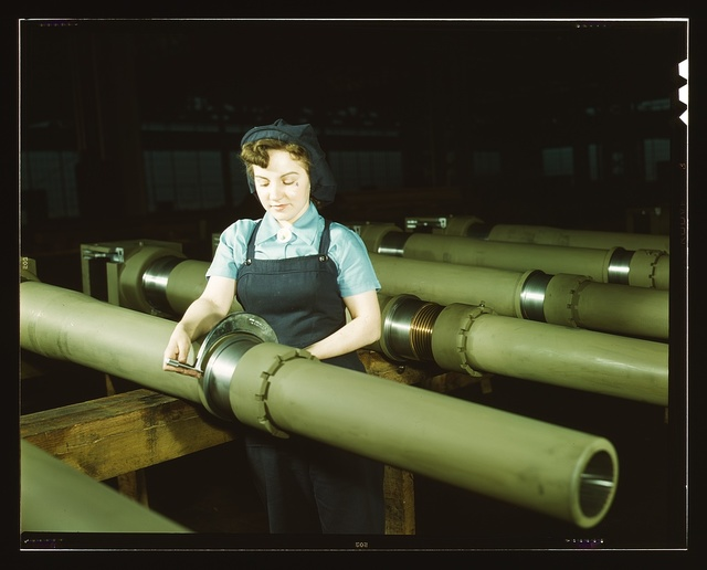 Gist inspector, Mrs. Mary Betchner inspecting one of the 25 cutters for burrs before inserting it in the inside of a 105mm. howitzer at the Milwaukee, Wis. plant of the Chain Belt Co. Her son is in the army; her husband is in war work