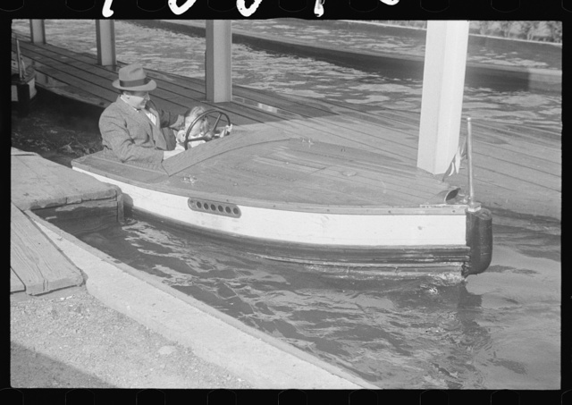 Glen Echo, Maryland. A man and a little girl taking a ride in a motor boat at Glen Echo Park