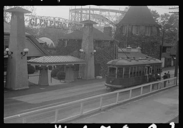 Glen Echo, Maryland. A view of the entrance of Glen Echo Park, showing persons alighting from a Cabin John streetcar in front of it