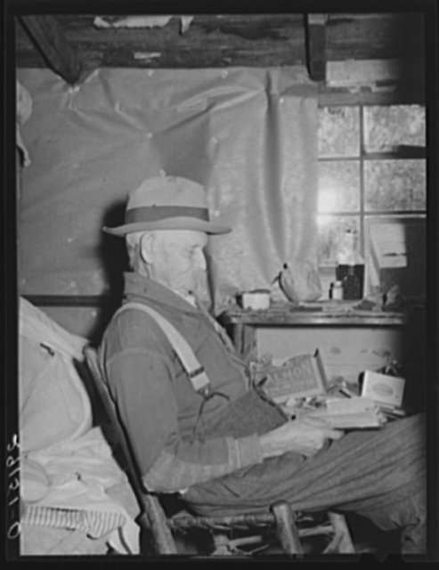 Grandfather of family living in paw-paw patch in the center of tiff miners. Washington County, Missouri