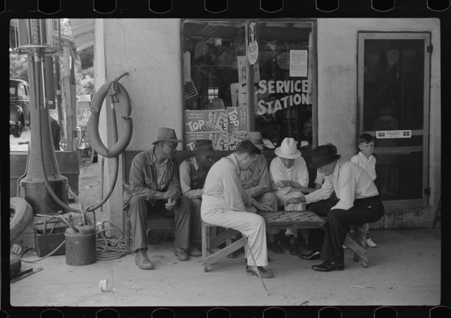 Greensboro, Greene County, Georgia. Playing checkers outside a service station on a Saturday afternoon