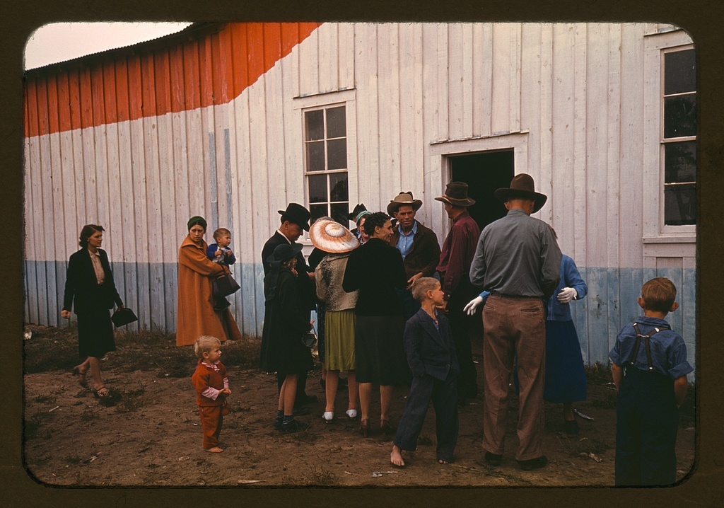 Group of homesteaders in front of the bean house which was used for exhibit hall at the Pie Town, New Mexico Fair