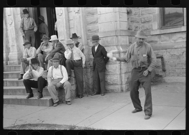 Group of residents of Weatherford, Texas, listening to politician speak