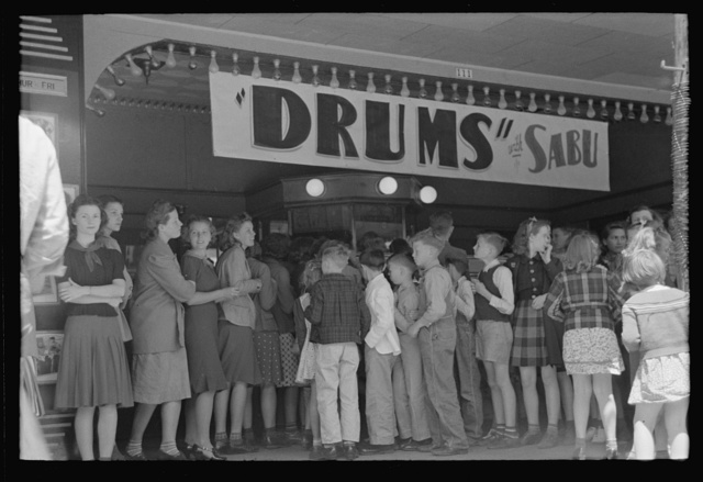 Group of schoolchildren waiting to get in the movies, San Augustine, Texas