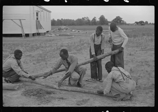 Group of sixth and seventh grade boys constructing poultry yard fence. Brooder was built in their shop class at school. Flint River Farms, Georgia