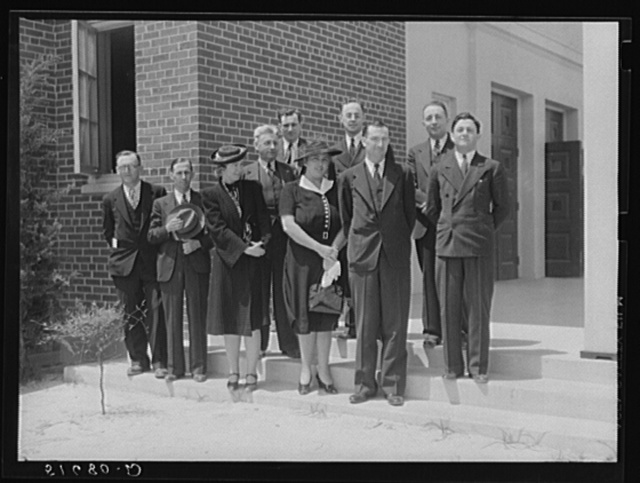Group of speakers and guests with project manager Mr. Cathcart (at extreme left) on steps of auditorium after May Day-Health Day program at Ashwood Plantations, South Carolina