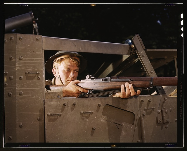 Halftrack infantryman with Garand rifle, Ft. Knox, Ky.