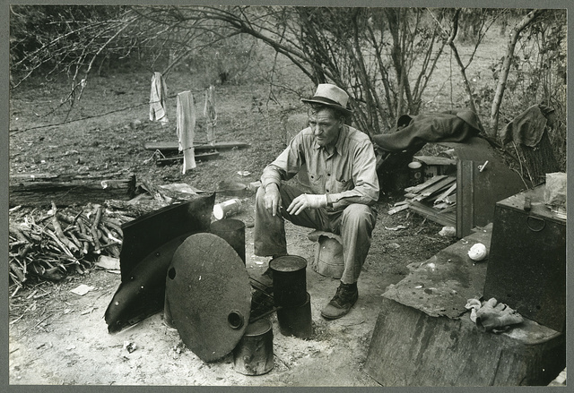 Harlingen (vicinity), Tex. Migrant worker sitting in front of fire. He lived with two other men workers