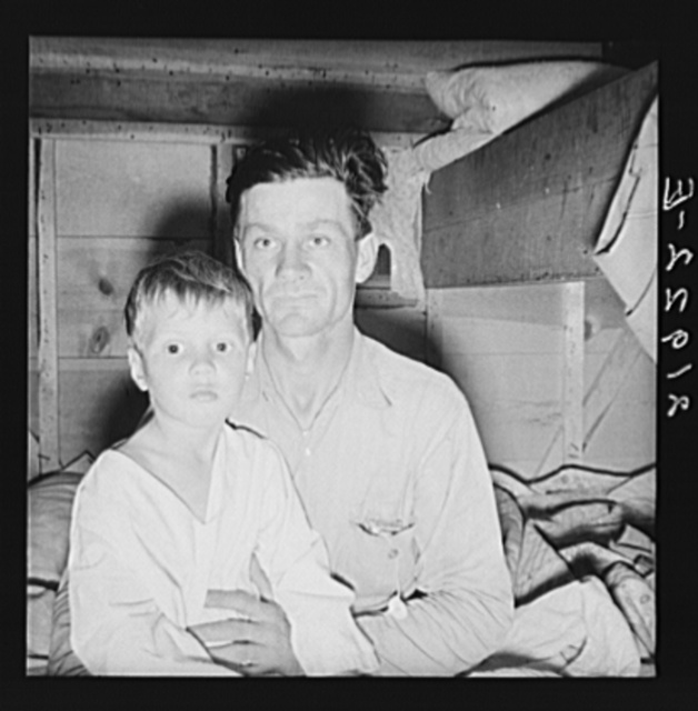 He brought his family to the west in a homemade trailer from Texas five months ago. Photograph made after supper. Boy sick. Father has work now in potato field. Merrill, Klamath County, Oregon. In mobile unit, FSA (Farm Security Administration) camp