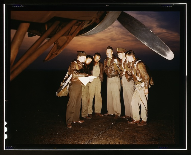 Here's our mission. A combat crew receives final instructions just before taking off in a mighty YB-17 bomber from a bombardment squadron base at the field, Langley Field, Va.