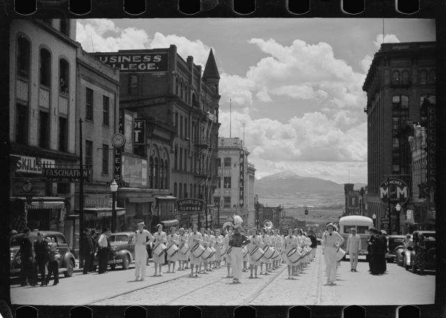 High school band parading up Montana Street, Butte, Montana