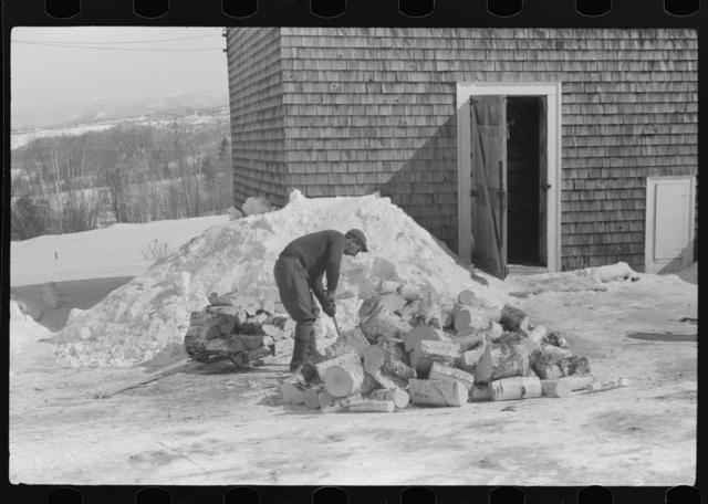 Hired hand on Mr. Dickinson's farm, splitting logs for winter fuel. Lisbon, near Franconia, New Hampshire