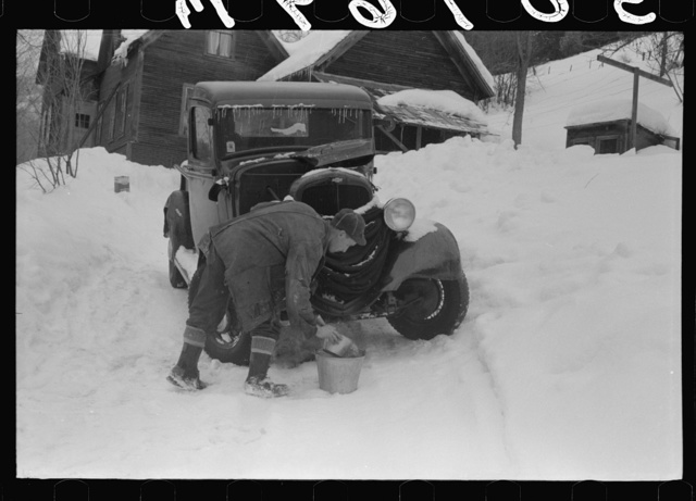 Hired man on farm near Woodstock, Vermont, usually empties the radiator in his car every evening and refills it again with water in the morning to save the cost of antifreeze
